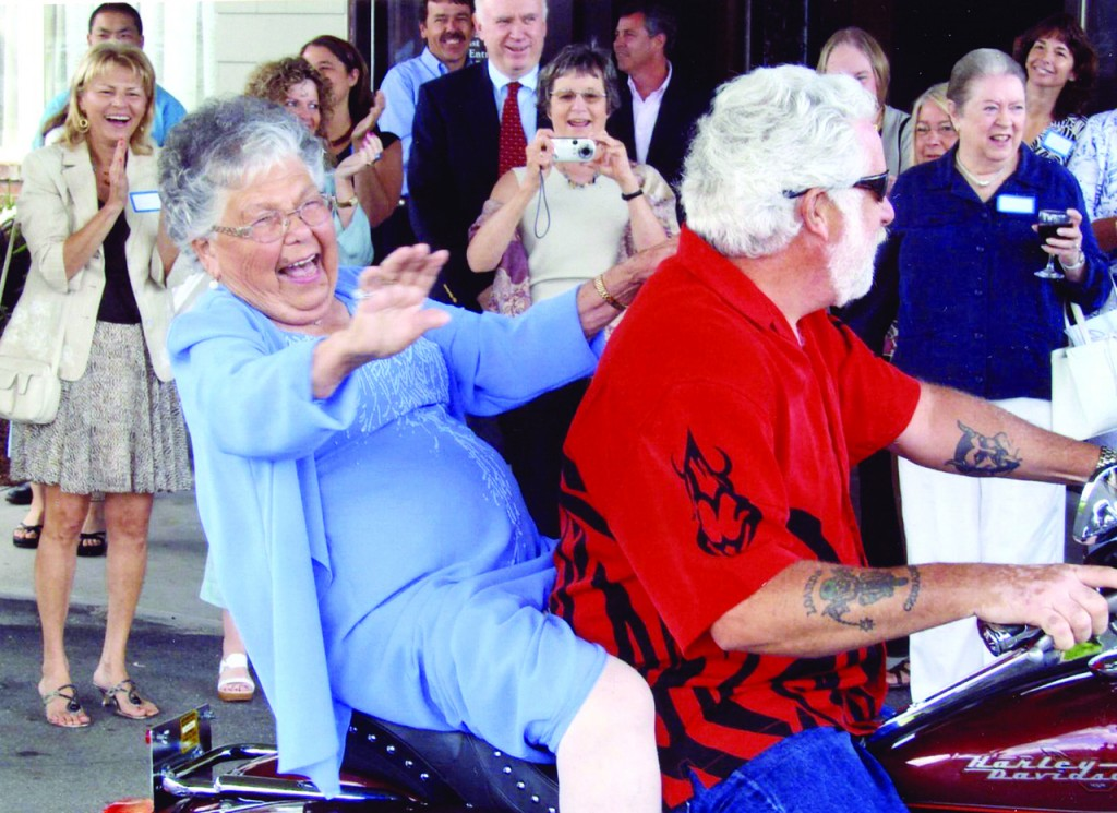 GRAND ENTRANCE: During an event honoring Catherine McKiernan Tierney with the Distinguished Graduate Award at Blessed Sacrament Parish, family members and friends shared favorite memories of the 96-year-old, including the time she arrived to her 90th birthday party on a red Harley Davidson, above.