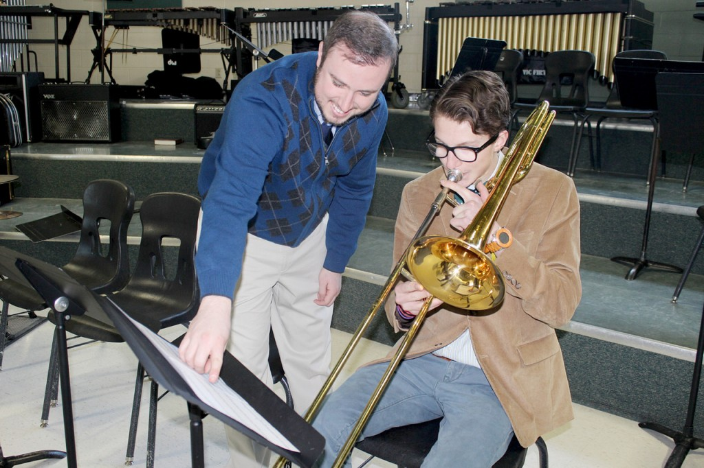 PRACTICE: Sean Donnelly, Bishop Hendricken High School?s director of bands (left), and junior Rocky Starks, 17, are looking forward to an eight-day performance tour in Hawaii. About 30 students from the Young Men?s Choir, as well as the school?s jazz ensemble and concert band, will head to Hawaii on Friday.