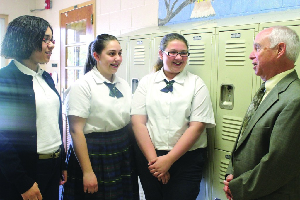 "PUTTING THE 'PAL' IN PRINCIPAL: Seventh graders (from left) Jada Bassette, Elissa Makhlouf and Isabella Dilonardo say they are going to miss Principal J. Robert McDermott, who is retiring after 43 years at the school. ""When I see him, it just brings my spirit up,"" said Makhlouf."