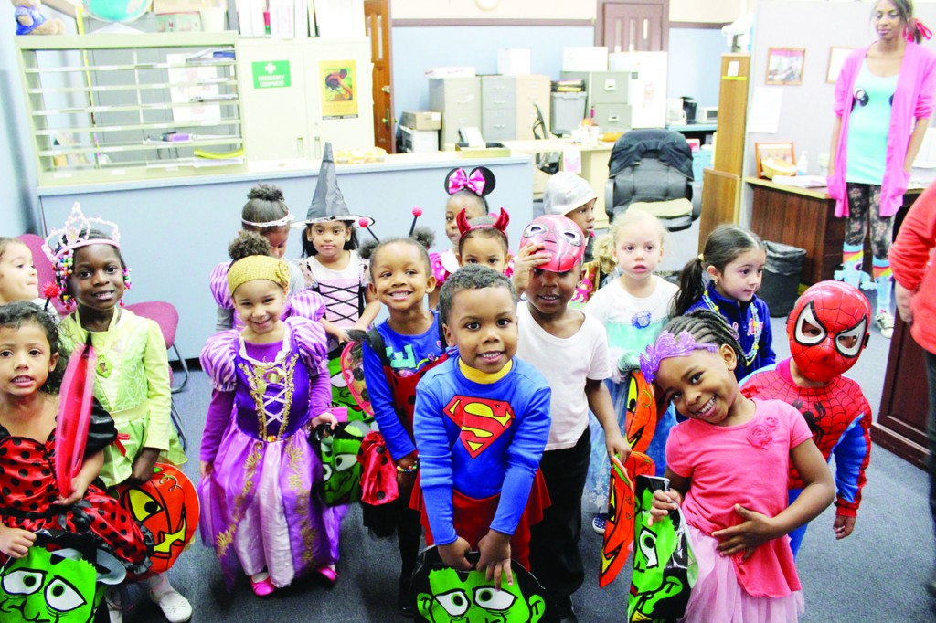 SUPER SCHOOL: With tuition assistance from the Catholic Charities Appeal, an annual fundraising campaign operated by the Diocese of Providence, many students at Bishop McVinney Catholic Elementary School are able to receive a faith-based education. Here, preschoolers show their enthusiasm for Halloween.