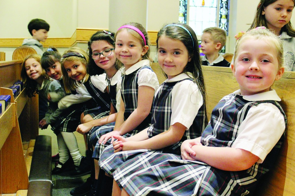 READY TO LISTEN: Kindergarteners (from right to left) gather in the church for Cooley's presentation, including Halie Long, Lorna Nassef, Chloe Griffin, Penelope Sargeant, Madeline Ford, Grace Deubel, and Margaret Baldwin.