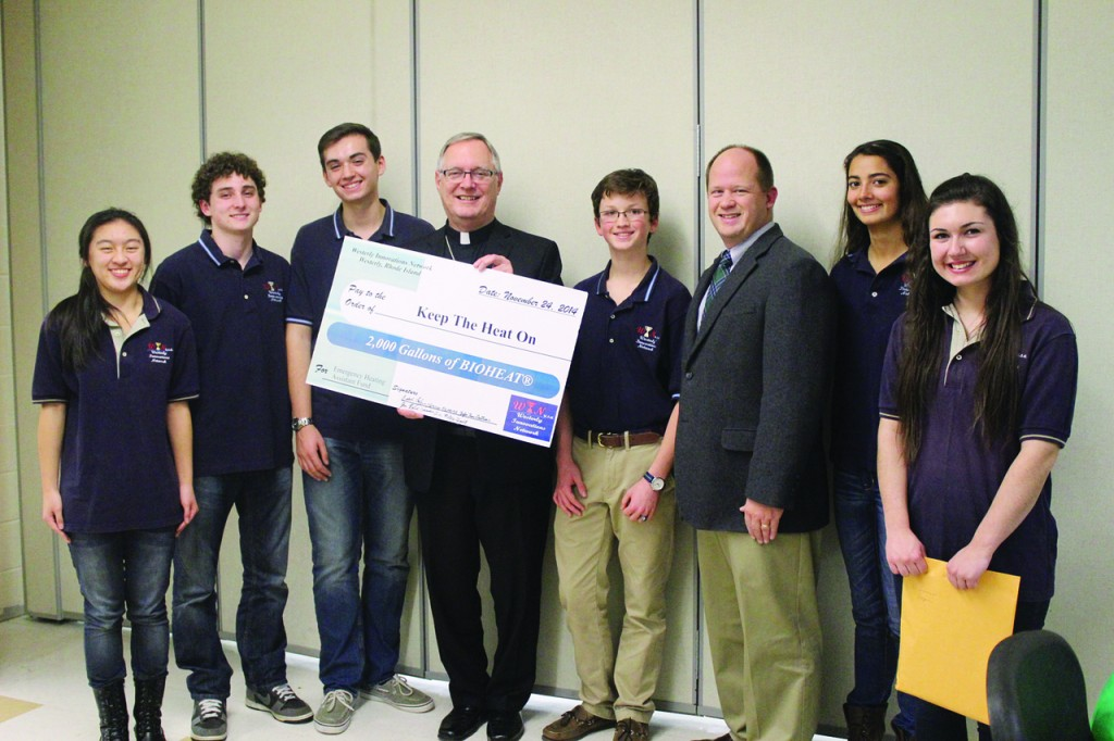 """INNOVATIVE STUDENTS: Bishop Thomas J. Tobin, along with Jim Jahnz, diocesan coordinator for emergency services, met with six student members of the Project Turn Grease Into Fuel (TGIF) program during a ceremony to honor eight charities that support people who require heating assistance. The bishop accepted a donation on behalf of his """"Keep the Heat On"""" campaign from (left to right) Cassandra Lin, Isaac Kaufman, John Perini, Miles Temel, Taylor Fiore-Chettiar and Vanessa Bertsch."""