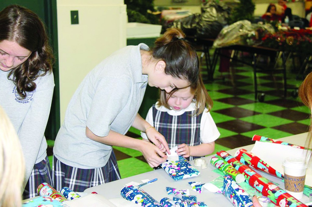 "TEAM WORK: During Catholic Schools Week, schools throughout the nation, including the Diocese of Providence, will be engaging students in faith-filled events, as well as offering open houses to prospective children and their parents. The week also highlights existing and new programs, such as the ""Buddy"" program at St. Margaret School in Rumford. Here, eighth grader Hayley Furtado and first grader Amber Dorman work together on a project, as the program connects older students with younger students."