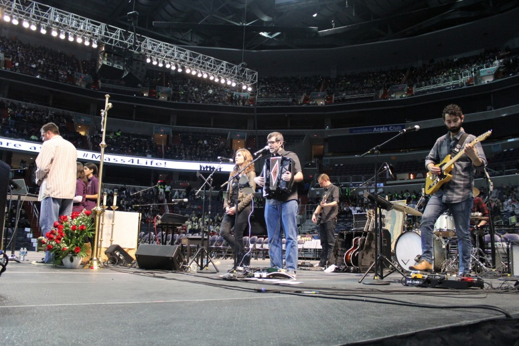 SINGING IS LIKE PRAYING TWICE: Supported by a backing band, Bob Rice, a musician and catechetic teacher at the Franciscan University of Steubenville in Ohio, performs for a crowd at the 2015 Youth Rally and Mass for Life. The event, which took place at the Verizon Center in Washington, D.C., preceded the March for Life.