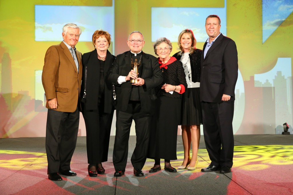 A GREAT WITNESS: Archbishop Charles J. Chaput, O.F.M. is presented with the JPII Award.  From left, John and Carol Saeman, Archbishop Chaput, Barbara Henkels, Michaelann and Curtis Martin.