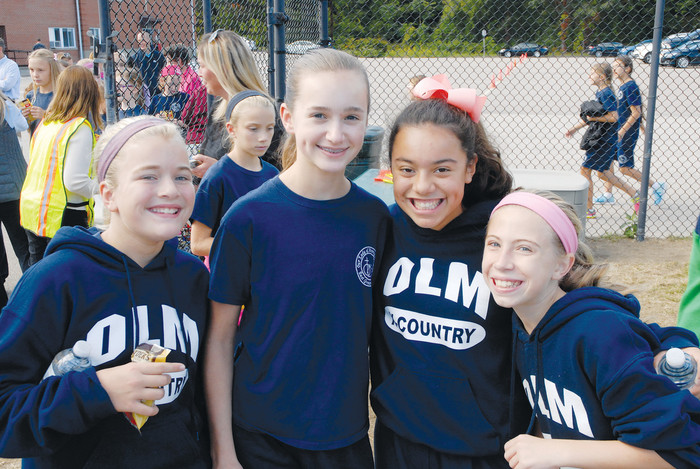 Seventh graders, from left to right, Allison Medeiros, Allison Lombardi, Alise Knudson and Jane Murpny celebrate finishing their walk.
