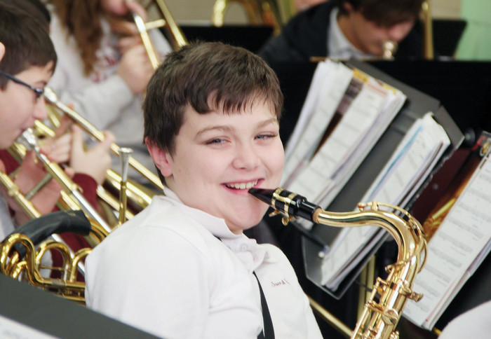 Fourth-grader Hunter Roman plays tenor saxophone in the Sacred Heart School Band.