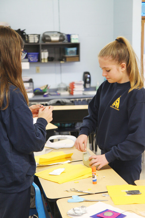TECH SUCCESS: On a Friday afternoon at All Saints Academy, students in grades 6 through 8 participate in semi-structured STEAM time, during which they work on independent or group projects, many of them related to the upcoming contact with the space station. Here, eighth-graders Caroline Rooney and Rayna Lombardo use conductive fabric to create an interactive presentation about the space race.