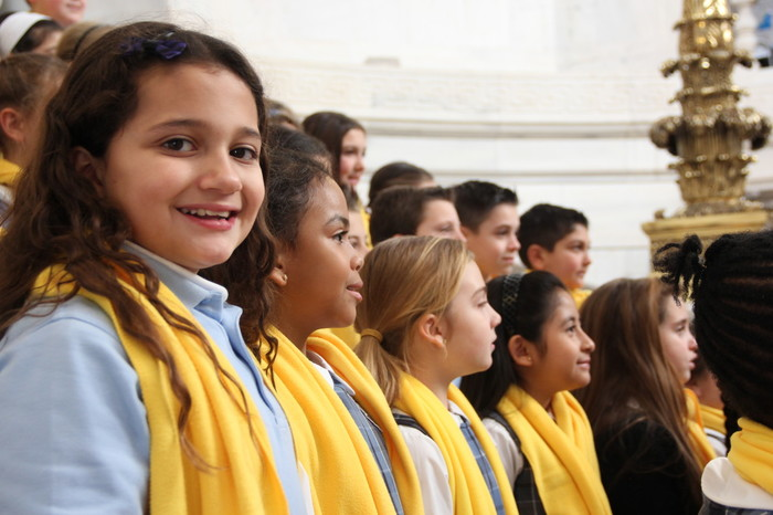 Many schools from around the Diocese of Providence will attend the upcoming State House rally on January 26 to show their support for school choice. Above, students sing on the rotunda steps at the State House during last year's event.