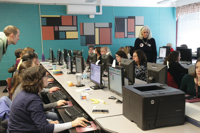 Catholic school teachers train to use Code.org, a free online learning platform that provides lessons in computer coding for students of all ages, during at workshop at St. Rocco School, Johnston, in December.