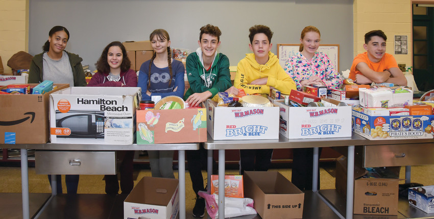 For Thanksgiving, eighth grade students at St. Augustine School in Providence, pictured above, recently held a food drive. The students collected boxes of food from each grade to help provide to eight different families as well as local food pantries.