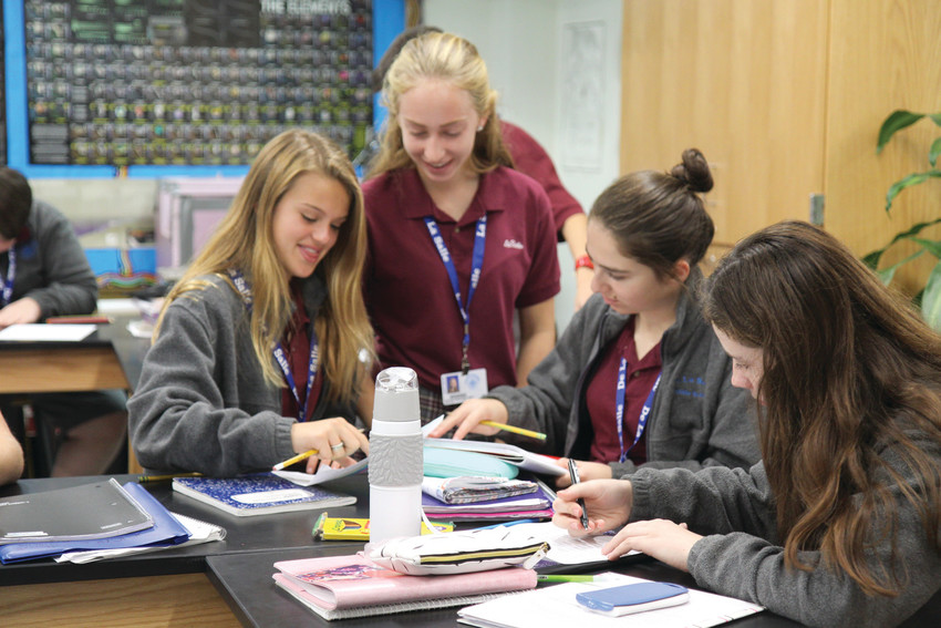 Students at La Salle Academy work together on classwork. Creating work spaces that support group-centered, technology-integrated learning is one of the priorities of many schools' current renovation projects.