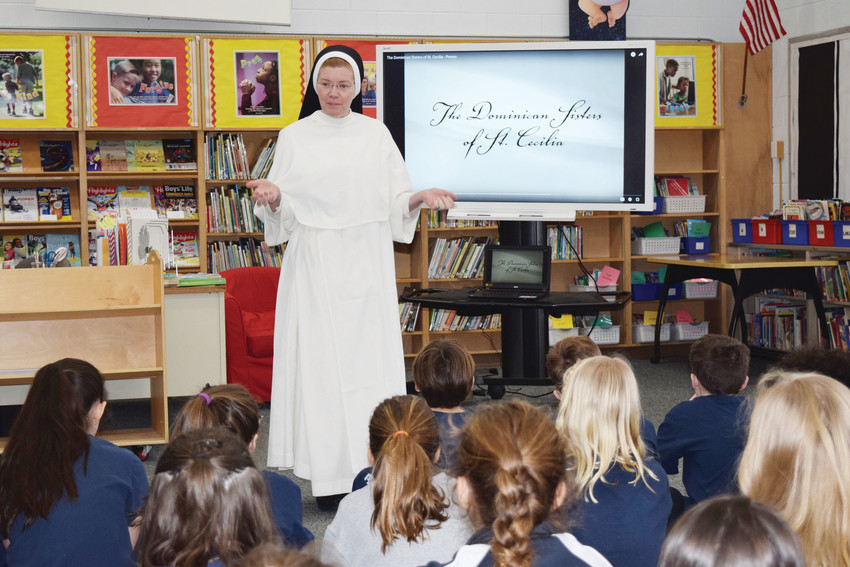 """Sister Anne Francis Klein, a campus minister from Providence College, is part of the Dominican order and wears her full habit. """"Her ability to connect with all of the children was amazing and we were so blessed to welcome her into our school as we learned more about her vocation,"""" said Sara Marshall, director of Advancement at Monsignor Clarke School."""