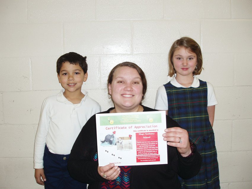 Pictured are Caden Andre, First grade techer Christina Charlska and Cassidy Caron.