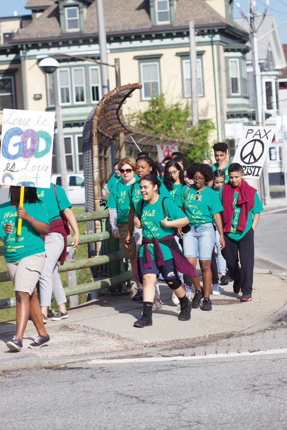 The school community of St. Patrick Academy begins their 12-mile walk from the school to La Salette Shrine in Attleboro, Massachusetts, as a prayer-in-action to reject violence and bring peace into the society.