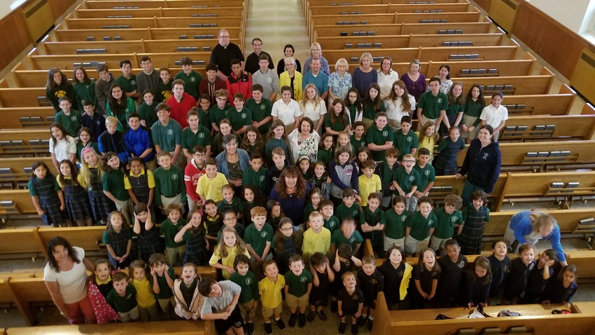 The student body of St. Pius X Regional Academy gathers for a group photo during the School Thanksgiving Mass on June 10. After 55 years of service, the Westerly school closed this year.