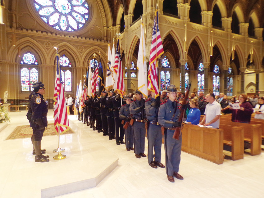 A color guard of officers present flags during last year's Mass for Public Safety in the Cathedral of SS. Peter and Paul, Providence.