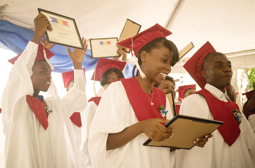 The Louverture Cleary School Class of 2016 celebrates after receiving their diplomas at graduation. The Haitian Project is embarking on a plan to develop The Louverture Cleary Schools Network in Haiti, a national system of 10 schools, one in each governmental department, providing 3,600 students with a rigorous, tuition-free Catholic secondary school education and supporting 1,200 students on scholarships to Haitian universities each year.