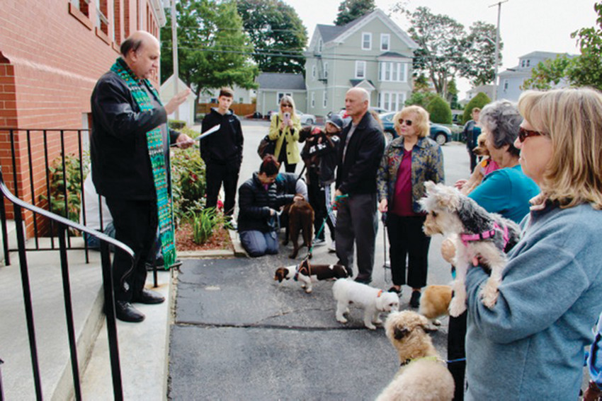 St. Agnes Church in Providence celebrated their annual pet blessing on October 6 in the church parking lot. Top, Father Frank S. Salmani, pastor, offered a special blessing upon the furry companions and invited parishioners and pets for refreshments following the ceremony.