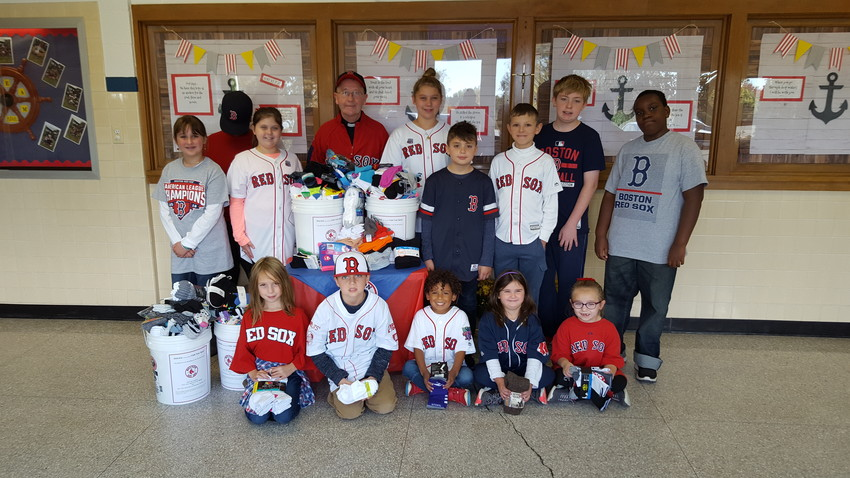 All Saints STEAM Academy in Middletown celebrated the Red Sox playing in the World Series by holding a Socks for the Sox collection. Students brought in socks and gloves that will be donated to a local charity. Father Francis O'Loughlin, a loyal Red Sox fan and pastor of Jesus Saviour and St. Joseph Churches, was on hand to celebrate a successful drive by the students to help those in need.