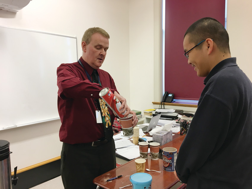"John Guevremont, English Department chair, makes hot chocolate with Wei (Peter) Li, a student from China. Guevremont shared that the exchange students at Mount Saint Charles Academy are ""diligent, hardworking, respectful and appreciative."""