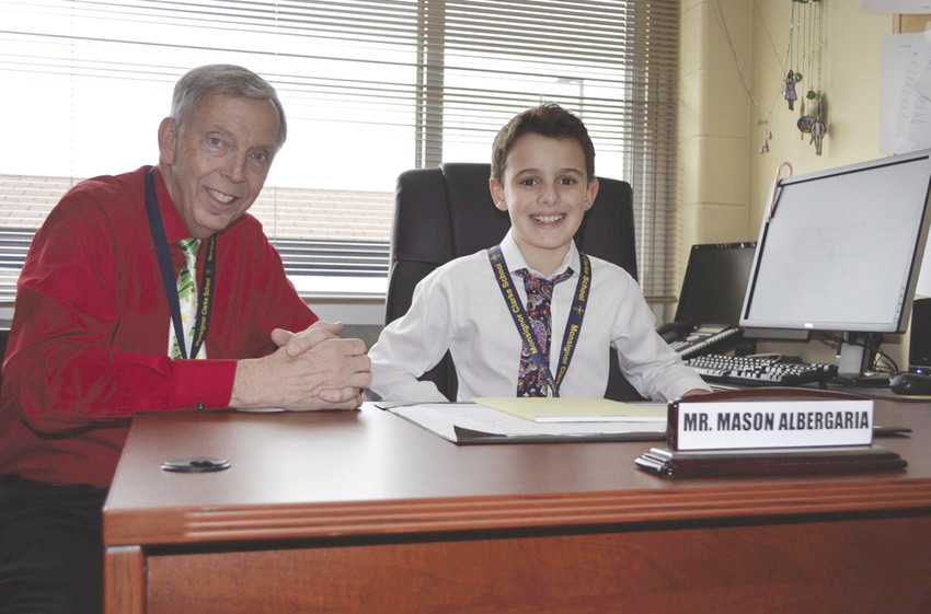 "Joined by Dr. Arthur W. Lisi, principal, fifth grader Mason Albergaia smiles as he enjoys being ""Principal of the Day."""