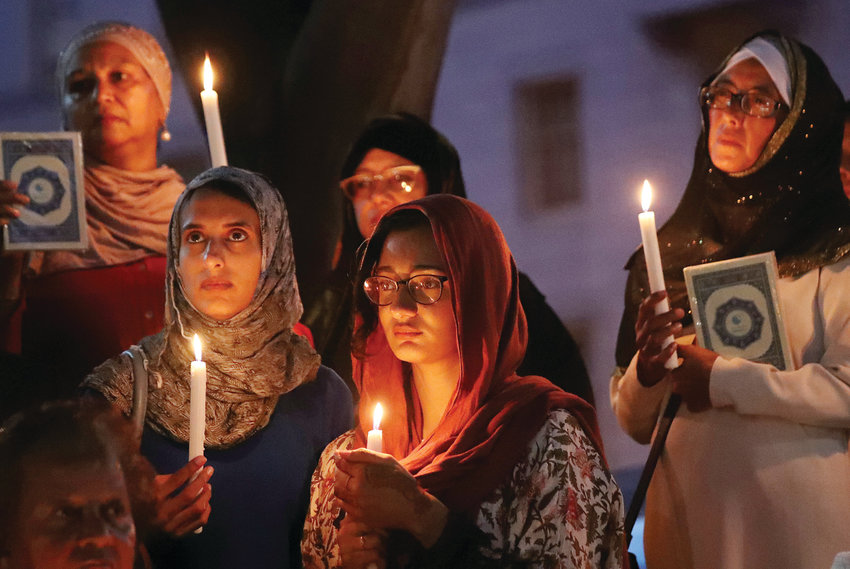 Women hold candles during a vigil outside St. George's Anglican Cathedral in Cape Town, South Africa, March 17, 2019, for the victims of the March 15 mosque attacks in Christchurch, New Zealand. (CNS photo/Mike Hutchings, Reuters)