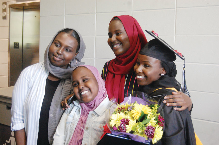 Fartun Abdulle, of Lawrence, Mass., smiles with her sisters, from left to right: Fardowsa, Aisha and Maka following graduation from Providence College.