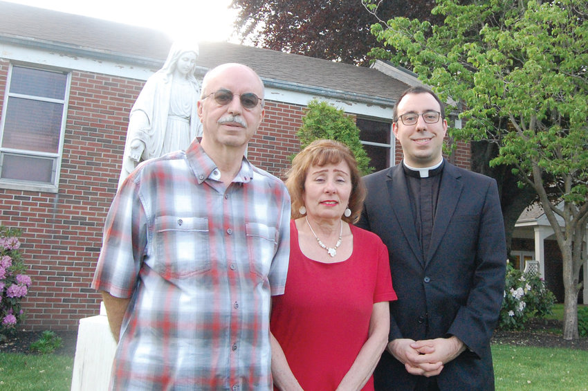 Deacon Eric Silva smiles with his parents Antonio and Theresa at St. Mark's Church in Cranston.