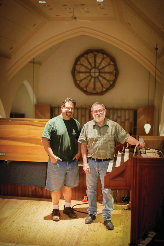Parish organist and music director Brian Mattias, left, and Charles Kegg, president and artistic director of Kegg Pipe Organ Builders stand beside the newest addition to Our Lady of Czestochowa Church in Coventry.