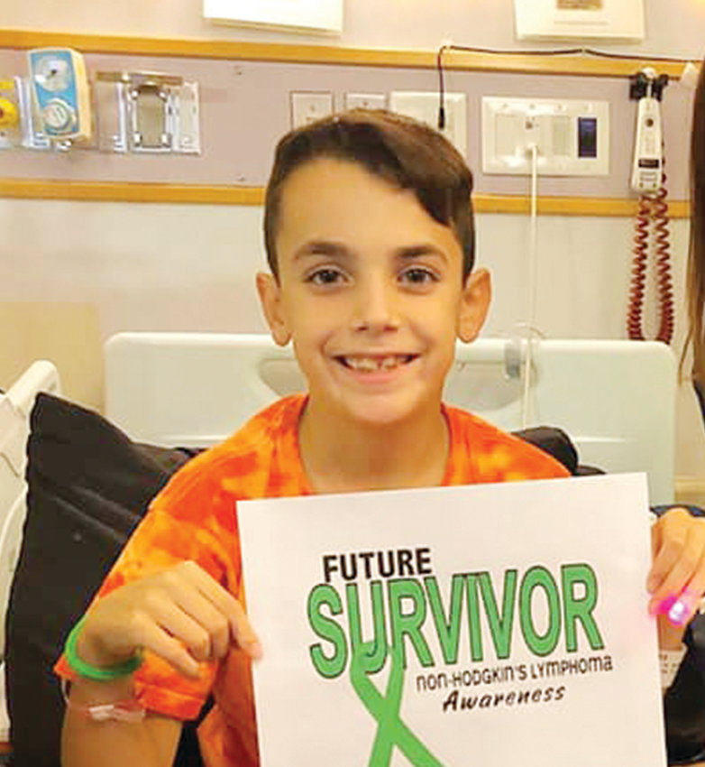 A prayer service was held last week for Noah Antunes, 10, parishioner of St. Michael Church, Smithfield, who is battling Burkitt Lymphoma. The community has come together to show their loving support for Noah.