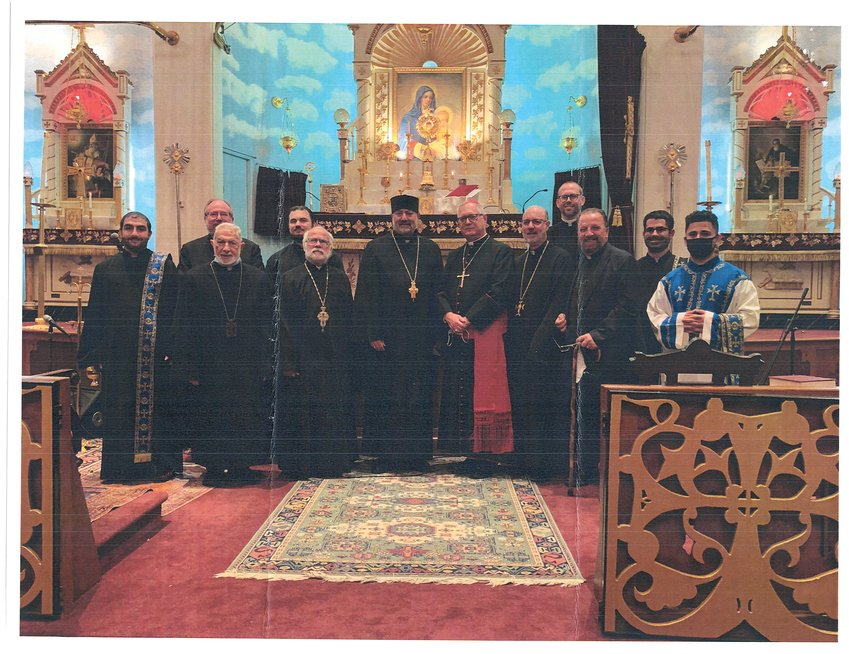 Pictured above, from left: Deacon Megrdichian, Father Joseph Santos, Father Nerses Jebejian, Father Nick Lanzourakis, Father Andrew George, Father Shnork Souin, Bishop Thomas J. Tobin, Father Kapriel Nazarian, Father Adam Young, Rev. Hagop Manjelikian, Deacon Michael Sabounjian, SDn. Aren Dawood. The participants wore masks for the service, removing them briefly for the photo.
