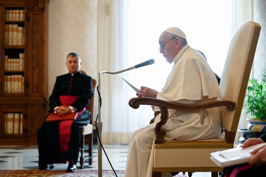 Pope Francis leads his weekly general audience from the library of the Apostolic Palace at the Vatican Jan 13, 2021. In his main talk, the pope focused on the importance of praising God in times of darkness and difficulty. (CNS photo/Vatican Media).