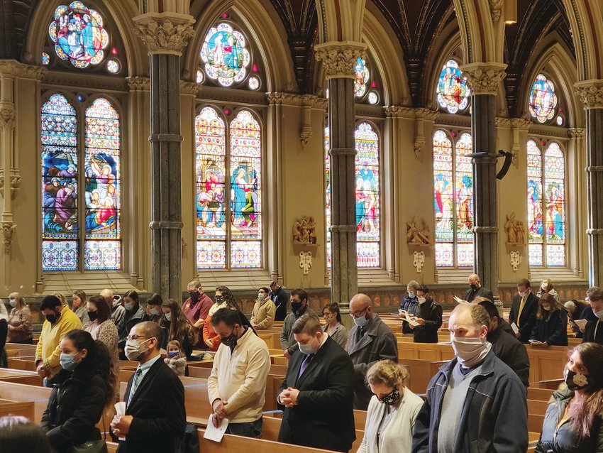 Catechumens and candidates, along with their sponsors, take part in the Rite of Election, which was held on Feb. 21 at the Cathedral of Saints Peter and Paul.