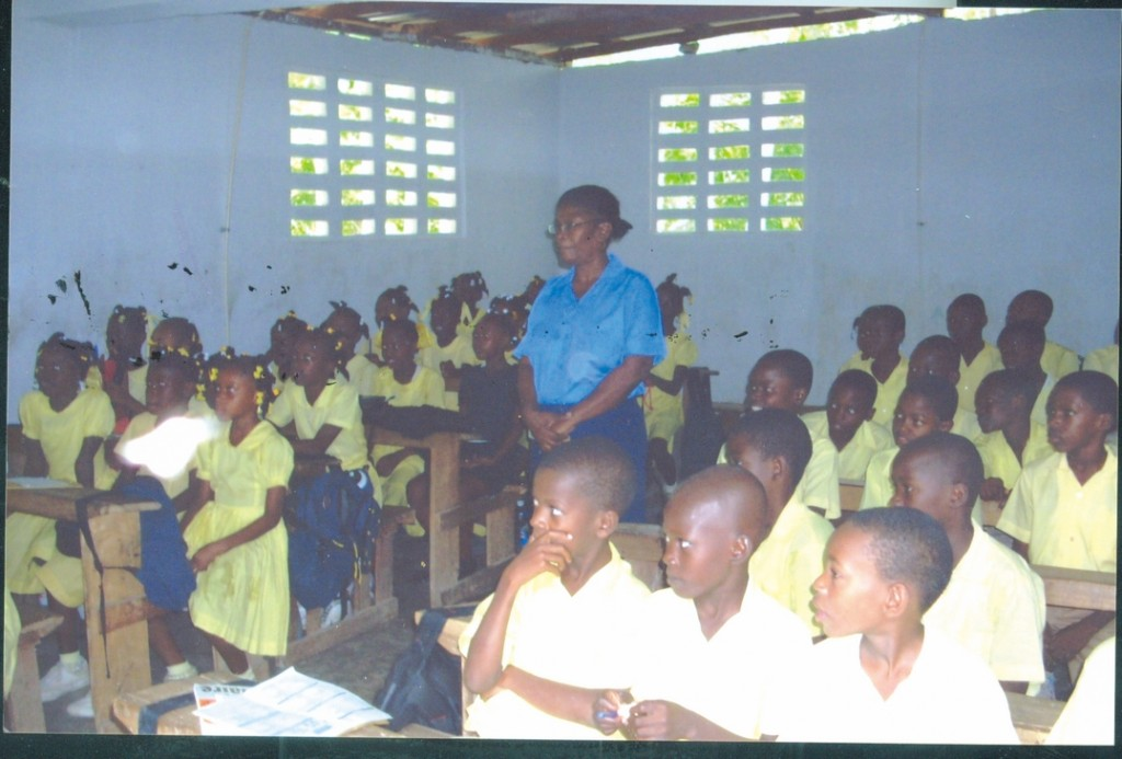 Fifth grade students attend class in a school building established with help from the group Providence-Haiti Outreach. The school began with only 50 students and has grown to offer free Catholic education to 350 students.