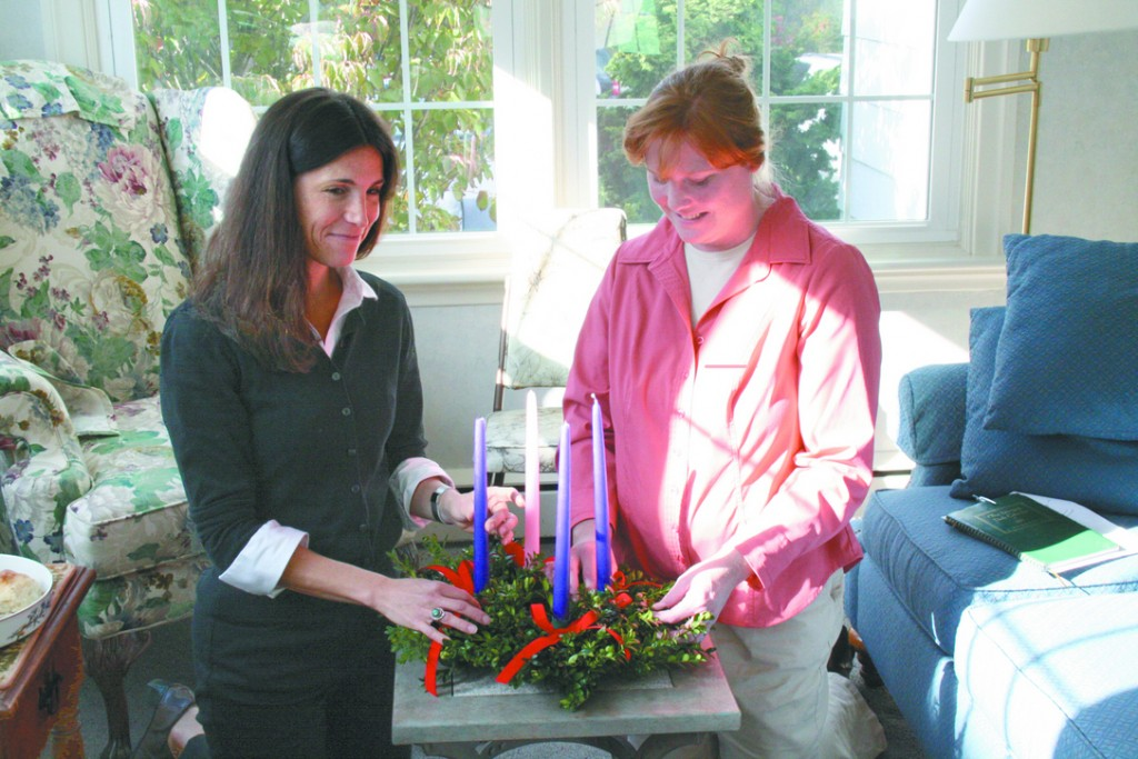 ADVENT PREPARATION: St. Luke parishioners Maura Fay (left) and Jennifer Gildea decorate an Advent wreath. Making wreath is one of many ways that local Catholics are keeping Christ in Christmas this year.